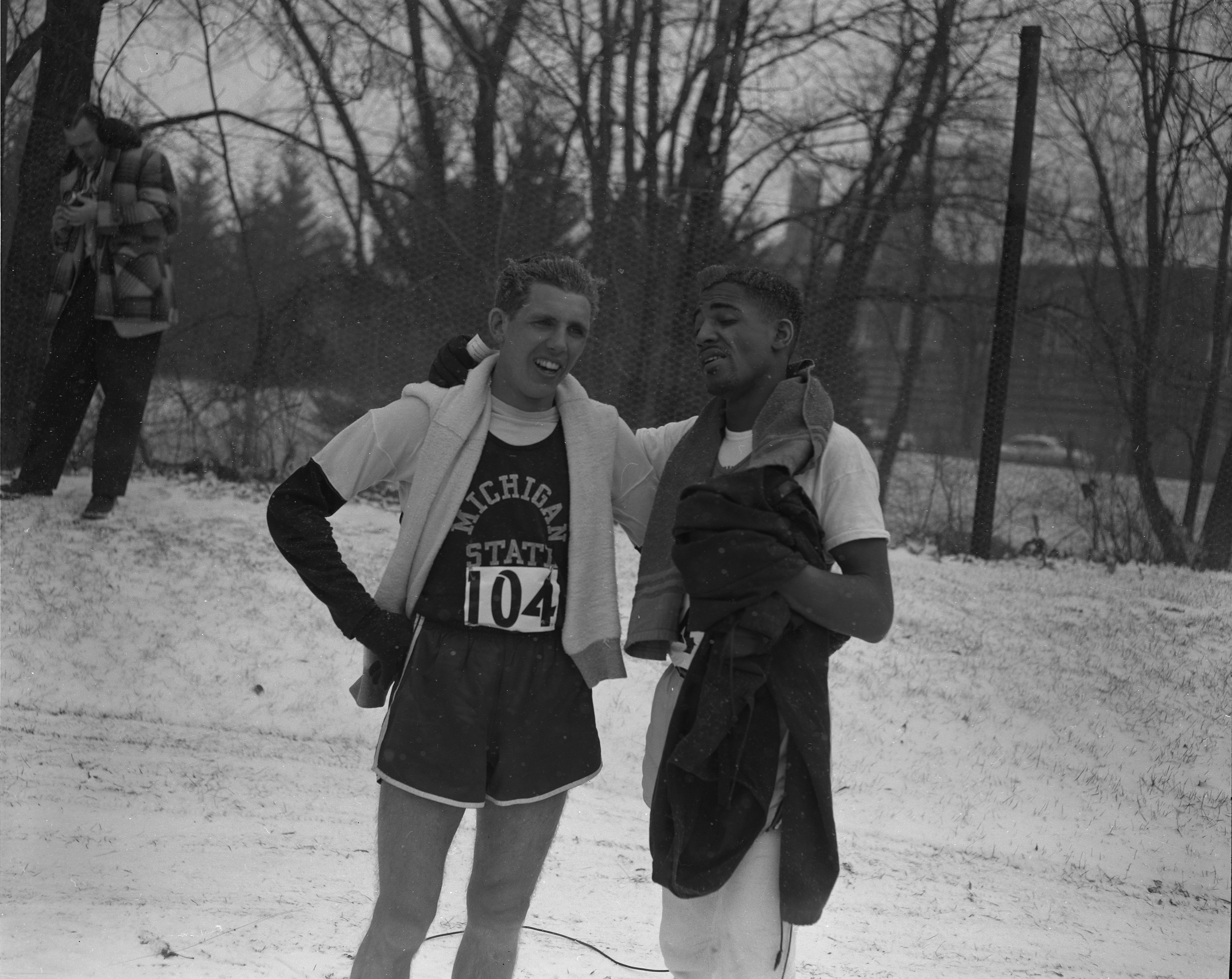 "Henry Kennedy (left) of Michigan State and Charles ""Deacon"" Jones after the 1955 NCAA Cross-Country Championship race"